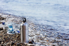 Reusable vs. disposable. Impact of disposables, like plastic water bottles, on clean water and the environment Royalty Free Stock Image