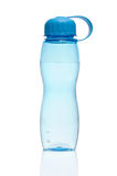 Reusable water bottle. A blue plastic reusable water bottle isolated on white stock photo