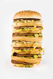Reusachtige drievoudige cheeseburger Stock Fotografie