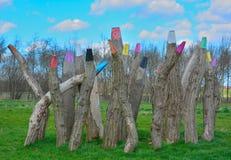 Reusachtige houten polen Stock Afbeeldingen