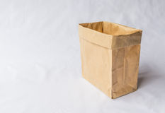 A reuse brown paper shopping bag. A brown paper bag vertical stand on grey background for reuse shopping bag Royalty Free Stock Image