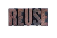 Reuse in letterpress wood type. The word 'reuse' in ink-stained wood letters isolated on white Stock Photos