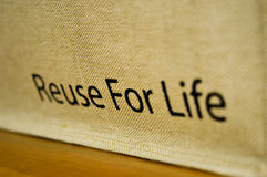 `Reuse For Life` text on calico bags. Concept for save a nature Stock Images
