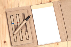 Reuse Note book with pen on a wooden Stock Photos