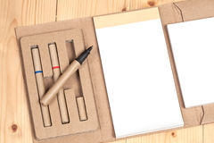 Reuse Note book with pen on a wooden Stock Photography