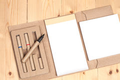 Reuse Note book with pen on a wooden Royalty Free Stock Photos