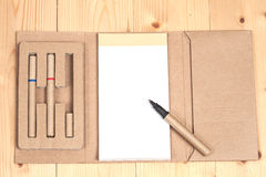 Reuse Note book with pen on a wooden Royalty Free Stock Photography