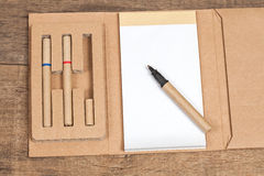 Reuse Note book with pencil on a wooden Royalty Free Stock Photos