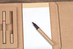 Reuse Note book with pencil on a wooden Stock Images