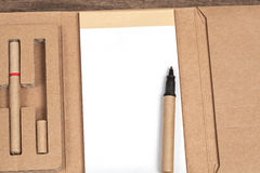 Reuse Note book with pencil on a wooden. Desk Royalty Free Stock Photography