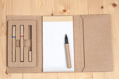 Reuse Note book with pencil on a wooden. Desk Stock Photography