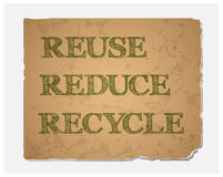 Reuse-Reduce-Recycle text on  recycled paper texture. Reuse-Reduce-Recycle text on blank grunge recycled paper texture.Save the world concept.Vector file Stock Photos