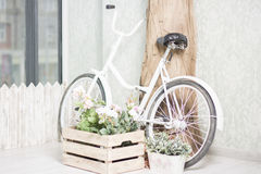 Reused bycycle with baskets of flowers stock image