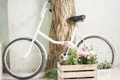 Reused bycycle with baskets of flowers royalty free stock photography