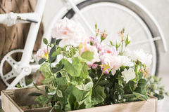 Reused bycycle with baskets of flowers royalty free stock image
