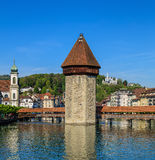 The Reuss river, Water Tower and Chapel Bridge in the city of Lu Stock Photos
