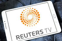 Reuters logo. Logo of reuters agency on samsung tablet stock images