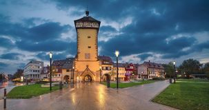 Tubinger Tor at dusk in Reutlingen, Germany. Reutlingen, Germany. Historic Tubinger Tor at dusk static image with animated sky stock footage