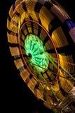 Reuzenrad met onduidelijk beeld op zwarte Royalty-vrije Stock Foto