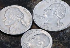 Revés de los 5 centavos de los E.E.U.U. de las monedas 25, 10 y Foto de archivo