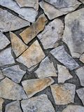 Revêtement de mur en pierre dans le style du pavage fou Photo stock