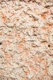 Revêtement texturisé durable rugueux de mur de stuc Fond inégal abstrait photographie stock