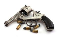 Revólver e balas foto de stock