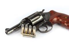 Revólver e balas do revólver Fotografia de Stock Royalty Free