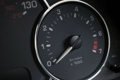 Rev counter on new car. Tachometer in a modern car intstrument cluster Royalty Free Stock Photo