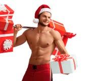 Rev sönder Santa Claus hållande skivstång och ge siggåvor Royaltyfri Bild