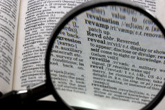 Reveal. The word 'Reveal' in the dictionary, magnified Royalty Free Stock Image