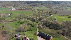 Reveal Farm At Valle Area Famous For Thousands Of Wild Cherry Blossom Trees, Pull Back Aerial