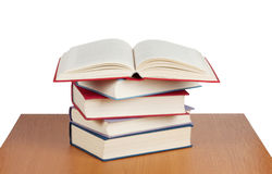 Revealed a red book. On a stack of books Royalty Free Stock Image