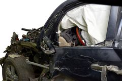 Revealed safety cushion in the very crumpled car in road accident isolated Stock Photos