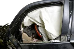 Revealed safety cushion in the very crumpled car in road accident isolated Stock Image