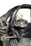 Revealed safety cushion in the very crumpled car in road accident isolated. Revealed safety cushion in very crumpled car in road accident isolated Royalty Free Stock Photo