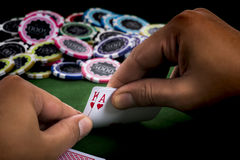 The revealing blackjack in hand. The Hands show chance of winning blackjack game and a pile of chips on the table at casino stock image