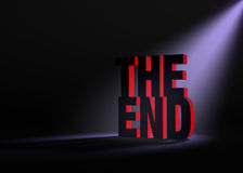 Revealing The End. Angled spotlight backlighting and revealing red THE END on a dark background Royalty Free Stock Images