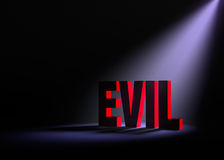 Revealing Evil. Angled spotlight backlighting and revealing red EVIL on a dark background Royalty Free Stock Photo