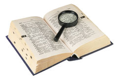 Revealling book with magnifying glass Stock Photos