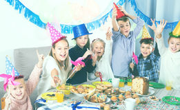 Revelers children having a good time at a birthday party Stock Photo