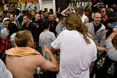 Revelers dancing in the street Stock Photography