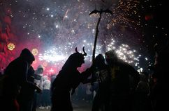 Correfoc in palma during saint sebastian local patron festivities. Revellers dressed as devils and holding fireworks take part in a traditional Correfoc fire run Royalty Free Stock Image