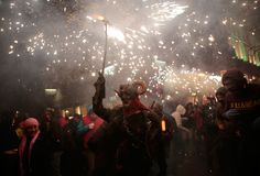 Correfoc in palma during saint sebastian local patron festivities. Revellers dressed as devils and holding fireworks take part in a traditional Correfoc fire run Stock Photos