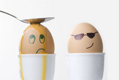 Revenge, punishment, violence, sadness, unhappiness, victim concept, faces drawn on boiled eggs. Cool dude egg dishes out punishment Stock Image