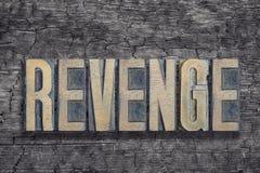 Revenge word burned wood Royalty Free Stock Photo