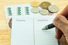 Revenu et dépenses Images stock