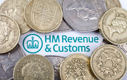 Revenue and Customs. Heading surrounded by coins royalty free stock photo