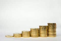 Revenue growth as shown by example of coins columns. Revenue growth as shown by the example of coins columns stock image