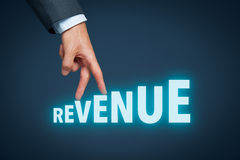Revenue. Increase revenue concept. Businessman represented by hand rise on increasing letters on word revenue Stock Image